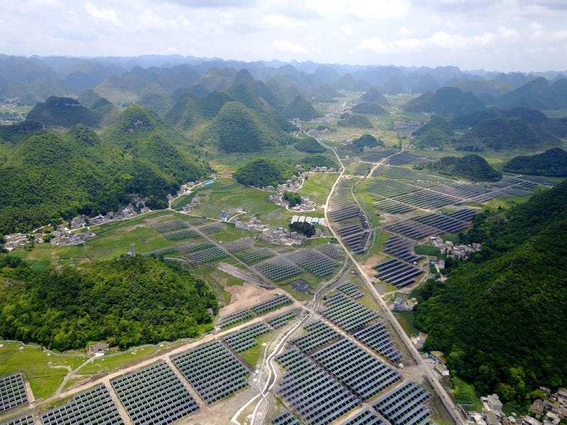 Greenhouses built with solar panels on their roofs, in Yang Fang village in Anlong, in China's southwest Guizhou province. STR/AFP/Getty Images