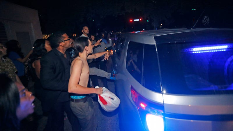 Protestors slap and kick a car transporting David Duke after a U.S. senate debate at Dillard University in New Orleans, Louisiana on Nov. 2. (Image via AP Photo/Gerald Herbert)