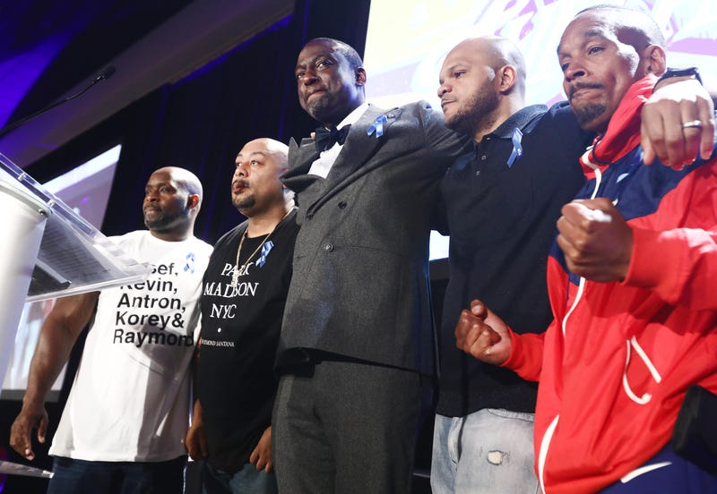 (L to R) Antron McCray, Raymond Santana, Yusef Salaam, Kevin Richardson and Korey Wise embrace on stage at the American Civil Liberties Union (ACLU) of Southern California's 25th annual awards luncheon on June 7, 2019, in Los Angeles.