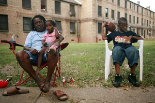 Jacquelyn Boyd and grandkids in the B.W. Cooper housing project in NOLA (Getty)
