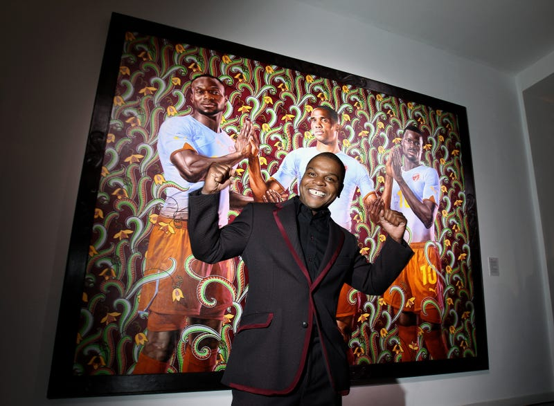 Kehinde Wiley stands in front of his painting during the Puma-Kehinde Wiley vernissage on Jan. 20, 2010, in Berlin.Andreas Rentz/Getty Images for PUMA