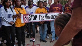 Residents of Chicago's West Garfield Park neighborhood march on Sept. 5, 2012, in Chicago after 15-year-old Telessia Shields was shot in the abdomen while walking home from school.Frank Polich/Getty Images