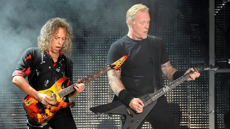 Kirk Hammett and James Hetfield aren't urinating in this picture, but let's just pretend they are. (Photo: Kevin Winter/Getty)