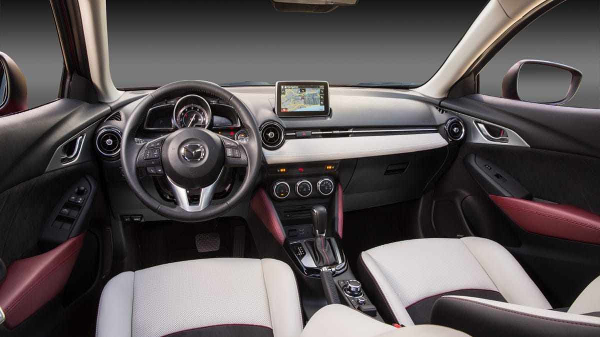 Difference between mazda 3 touring and grand touring