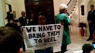 A Black Lives Matter activist identified as Ashley Williams holds a sign referencing a statement Hillary Clinton made during a 1996 speech.YouTube screenshot