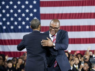 Barack Obama and Tyler Perry greet each other. (AFP)