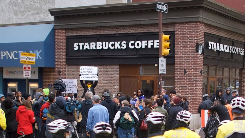 Police monitor activity as protestors demonstrate outside a Center City Starbucks on April 15, 2018, in Philadelphia.