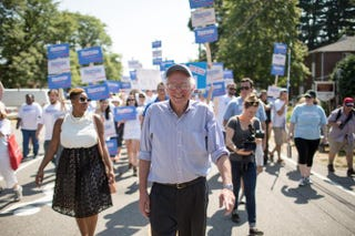 Sen. Bernie Sanders (center) and his national press secretary, Symone Sanders (left), march in the Labor Day parade in Milford, N.H., September 2015.Courtesy of Sanders 2016 Campaign