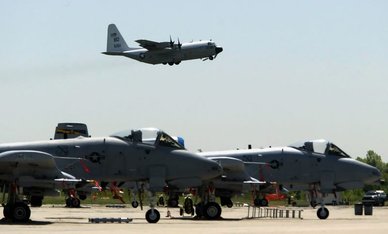 A-10 Warthogs from the 111th Fighter Wing are seen in the foreground as a U.S. Navy C-130 takes off from N.A.S. J.R.B. Willow Grove, Friday, May 13, 2005, in Willow Grove, Pa. (AP Photo/Joseph Kaczmarek)
