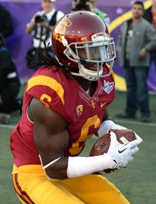 Josh Shaw of the University of Southern California Trojans intercepting a pass during a game in Las Vegas Dec. 21, 2013.Ethan Miller/Getty Images