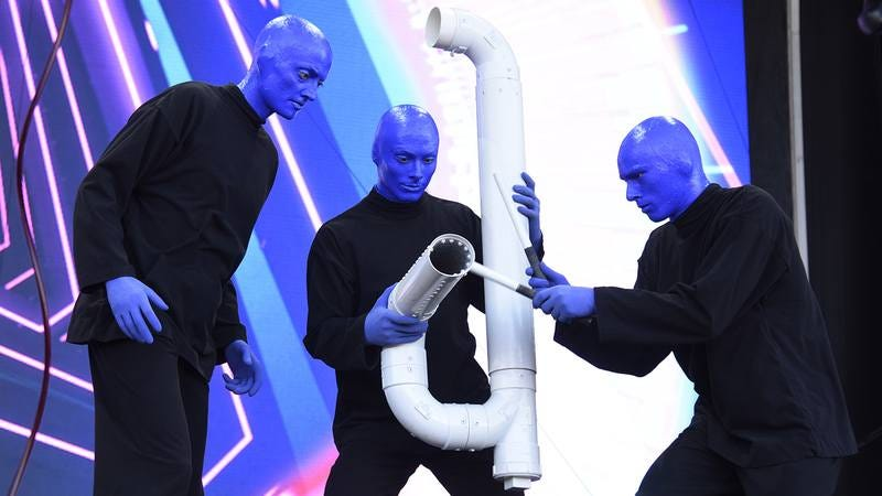 The Blue Man Group performing.