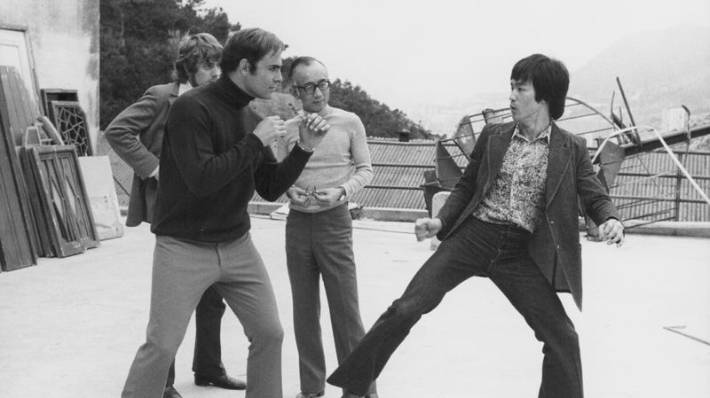Raymond Chow (center) standing between John Saxon and Bruce Lee on the set of Enter The Dragon.