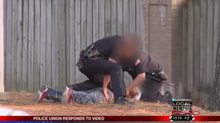 Memphis, Tenn., police officers apprehend a suspect in a domestic dispute.Local 24 screenshot