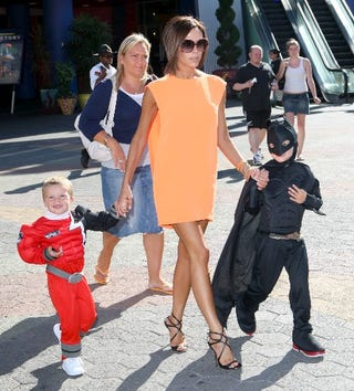 Illustration for article titled Victoria Beckham, Stiletto-Wearing Supermom