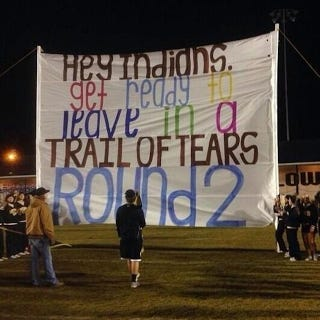 "Illustration for article titled Alabama High School Mocks Indians Opponent With ""Trail Of Tears"" Sign"