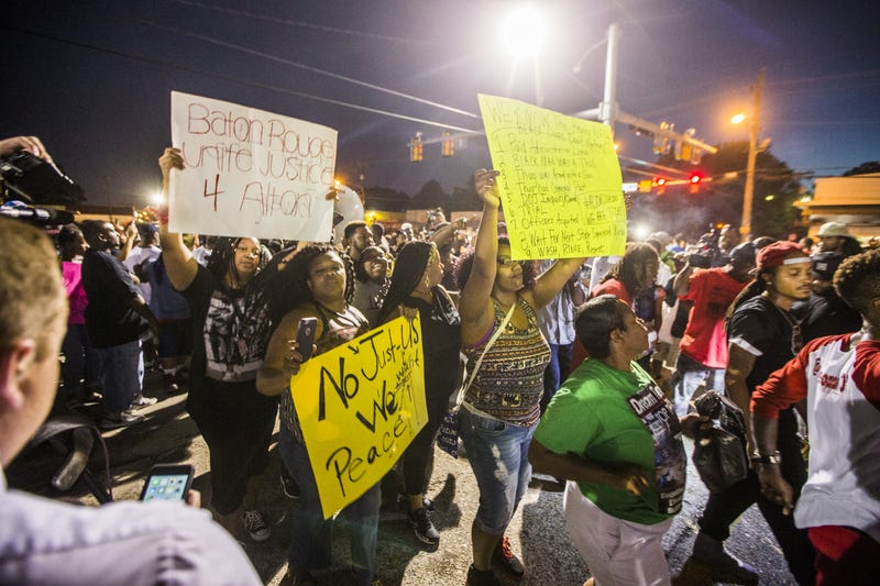 Protesters march July 6, 2016, to the Triple S Food Mart convenience store in Baton Rouge, La., where Alton Sterling was shot and killed July 5, 2016.Mark Wallheiser/Getty Images