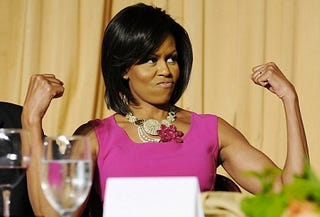 "First Lady Michelle Obama flexes her famous ""guns."""