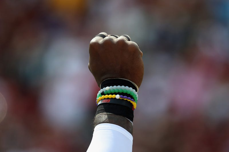 Strong safety Malcolm Jenkins of the Philadelphia Eagles holds his fist in the air during the national anthem before the start of the game between the Eagles and Washington, D.C.'s NFL team at FedExField on Sept. 10, 2017. (Rob Carr/Getty Images)
