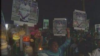 Protestors hold a vigil for Akil DenkinsTwitter