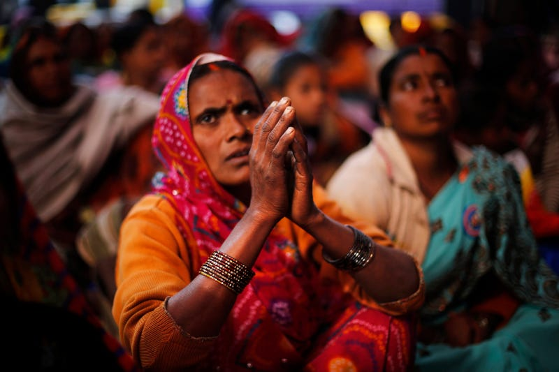 An Indian Dalit woman, a member of the outcast community once known as untouchables, listens to a speaker with folded hands at a sit-in protest on Human Rights Day near the Indian Parliament in New Delhi on Dec. 10, 2013. The Dalits were demanding rights to land, livelihood and equal growth opportunities. (Altaf Qadri/AP Images)