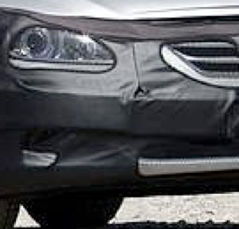 Illustration for article titled 2011 Hyundai Genesis Shows A New Mr. Ed-Like Grille