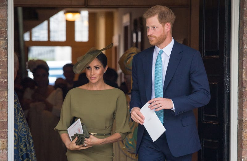 The Duchess and Duke of Sussex depart after attending the christening of Prince Louis at the Chapel Royal, St James's Palace on July 09, 2018 in London, England.