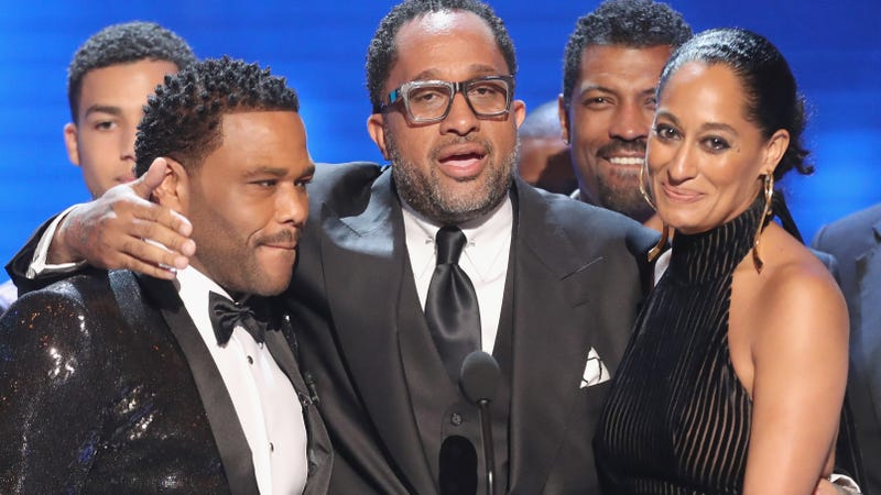 Anthony Anderson, Kenya Barris and Tracee Ellis Ross accept Black-ish's award for Outstanding Comedy Series at the 48th NAACP Image Awards at Pasadena Civic Auditorium in California on Feb. 11, 2017.