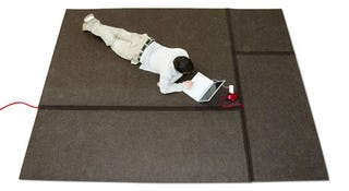 Illustration for article titled Cablet Carpet Helps You Hide the Evidence of Your Geekyness