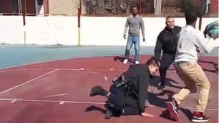 Samir Hill is seen crossing up a Philadelphia police officer during a pickup basketball game.YouTube Screenshot