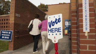 People enter Cotswold School in Charlotte, N.C., to vote Nov. 4, 2014. North Carolina's voting-rights law goes on trial July 13, 2015.Davis Turner/Getty Images