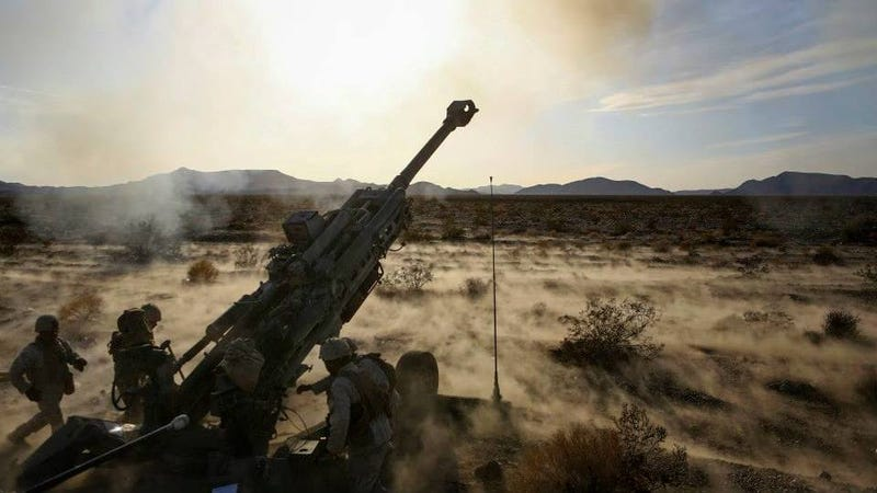 Marines with 1st Battalion, 11th Marine Regiment, 1st Marine Division, fire an M777 howitzer during Exercise Desert Scimitar 2015 aboard Marine Corps Air Ground Combat Center Twentynine Palms, California, April 7, 2015. – United States Marine Corps
