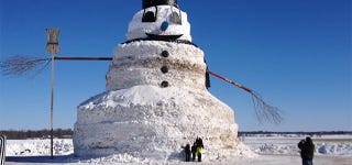 Man builds giant 50-foot-tall snowman with entire trees for arms
