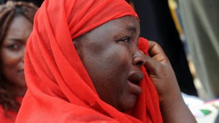 One of the mothers of the missing schoolgirls wipes her tears as she cries during a rally.PIUS UTOMI EKPEI/AFP/Getty Images