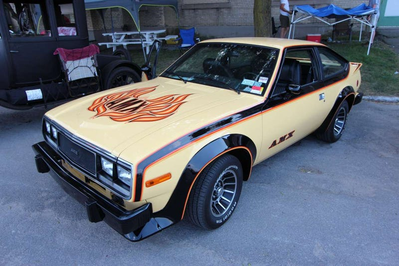 The AMC Spirit AMX has stickers and wheel flares
