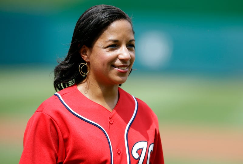 Susan Rice, former United States Ambassador to the United Nations, and the National Security Adviser, smiles after throwing out a ceremonial first pitch before a baseball game between the New York Mets and the Washington Nationals at Nationals Park Saturday, July 27, 2013, in Washington.