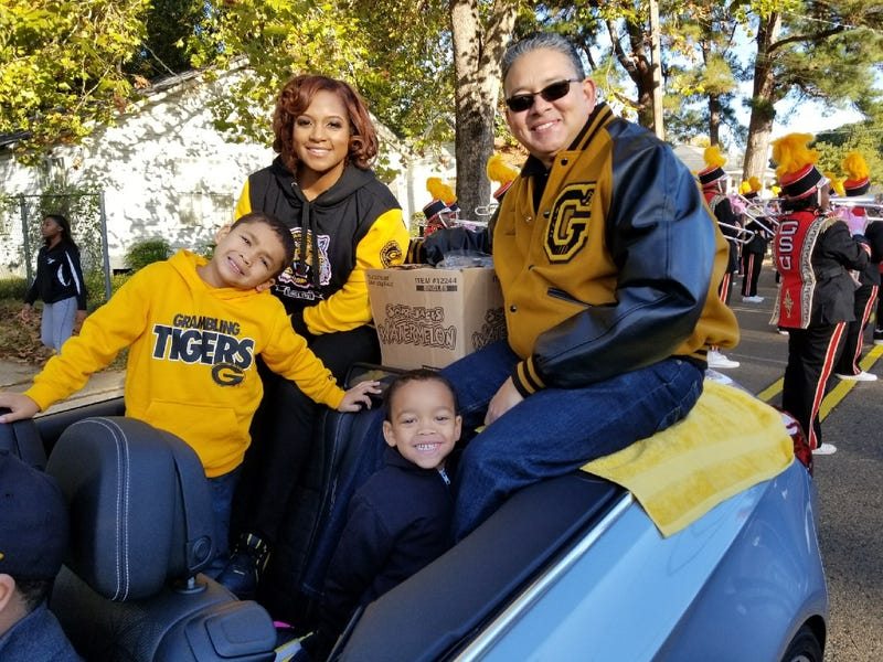 Grambling State University President Richard Gallot Jr. (right) rides in the homecoming parade in Grambling, La., with his wife, Christy, and sons. (Richard Gallot Jr.)