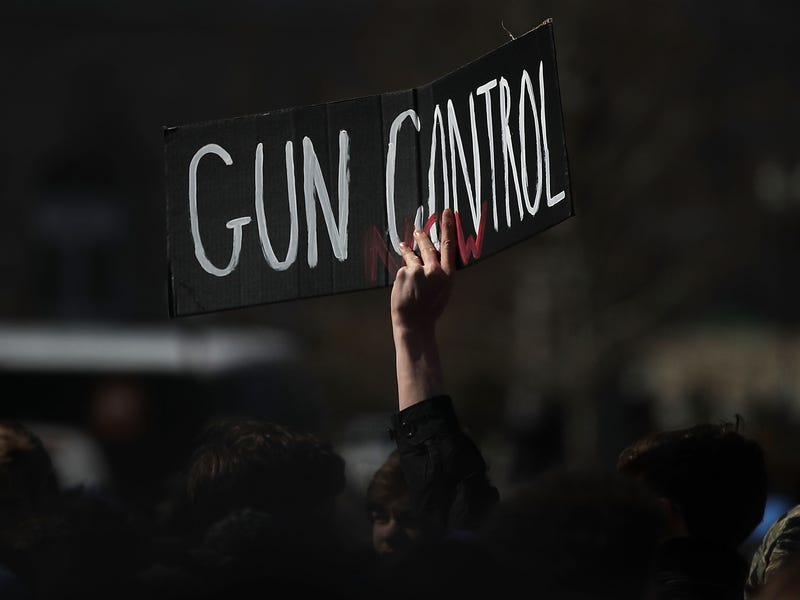 A student holds up a sign during a gun control rally at the U.S. Capitol last March, held after the Parkland school shooting