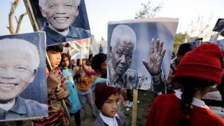 Children gather in Islamabad, Pakistan, on Dec. 10, 2013, to pay tribute to Nelson Mandela.Metin Aktas/Anadolu Agency/Getty Images
