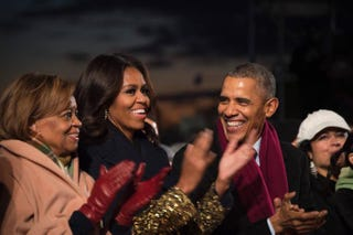 President Barack Obama (right) shares a laugh with first lady Michelle Obama (center) and his mother-in-law, Marian Robinson (left), during the National Christmas Tree lighting ceremony outside the White House Dec. 3, 2015, in Washington, D.C.Jim Watson/Getty Images