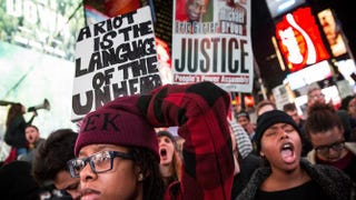 People protest in Times Square Nov. 25, 2014, in New York City over the grand jury decision not to indict then-Officer Darren Wilson in the Michael Brown case in Ferguson, Mo.Andrew Burton/Getty Images