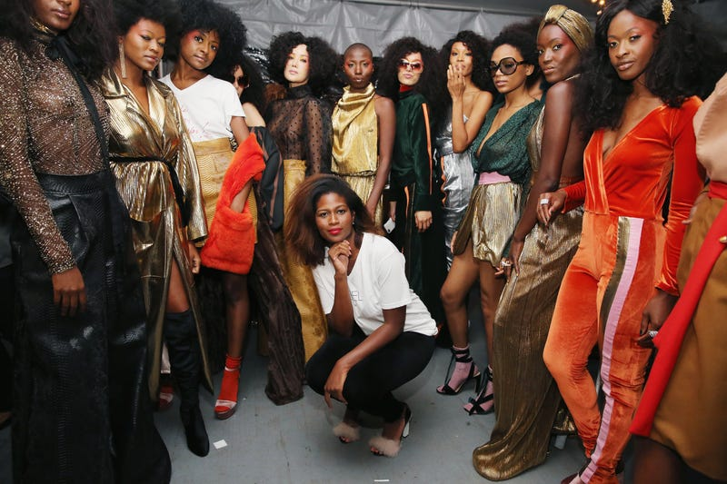 Fashion designer, Fe Noel (C), poses backstage during Harlem's Fashion Row Celebrates 10th Anniversary Style Award and Fashion Show on September 6, 2017 in New York City.