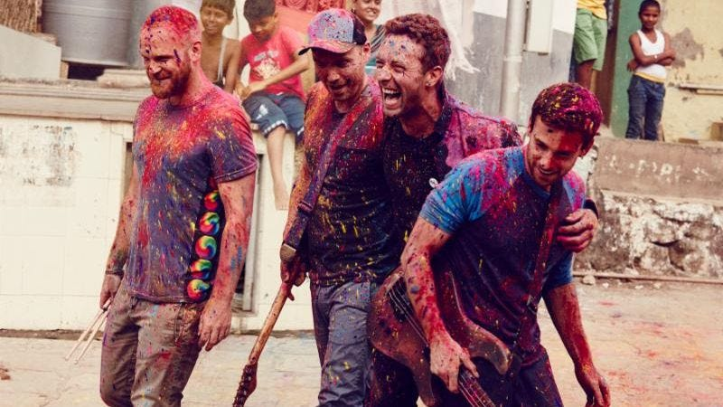 Coldplay, once more drenched in the blood of favela children (Credit: Julia Kennedy)