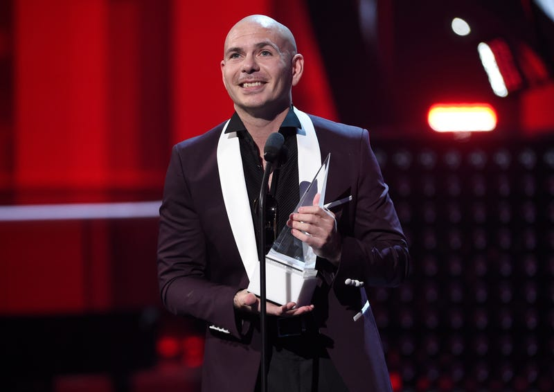 Pitbull accepts the Latin AMA Dick Clark Achievement Award at the Latin American Music Awards at the Dolby Theatre on Oct. 26, 2017, in Los Angeles. (Chris Pizzello/Invision/AP Images)