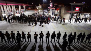 Police in riot gear hold a line as they watch demonstrators Oct. 12, 2014, in St. Louis protest the shooting deaths of Michael Brown and Vonderrit Myers Jr. Joshua LOTT/AFP/Getty Images