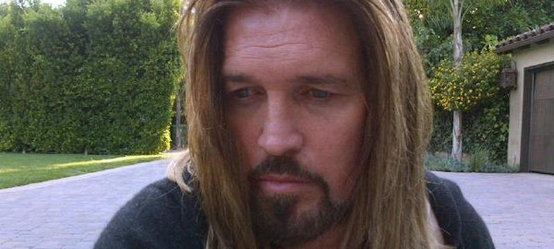 Illustration for article titled What Is Billy Ray Cyrus Doing In His Driveway?