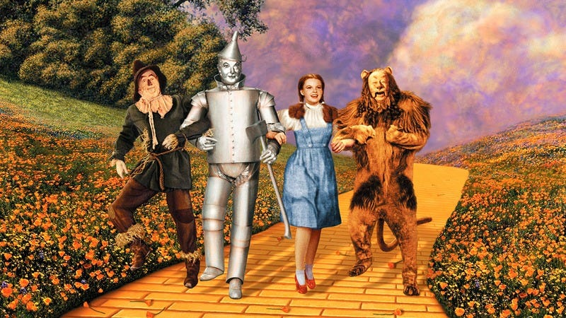 Characters from 'The Wizard Of Oz' on the yellow brick road.