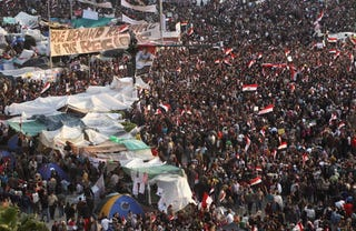 Protesters celebrate the ouster of President Hosni Mubarak.