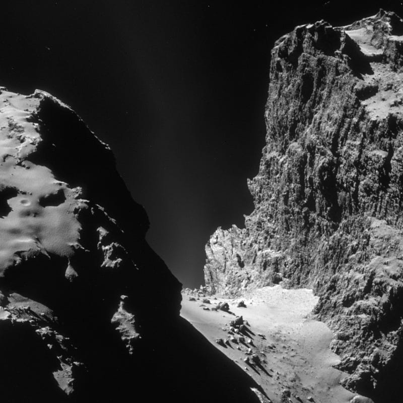 Illustration for article titled New photo reveals titanic cliffs on Rosetta's comet