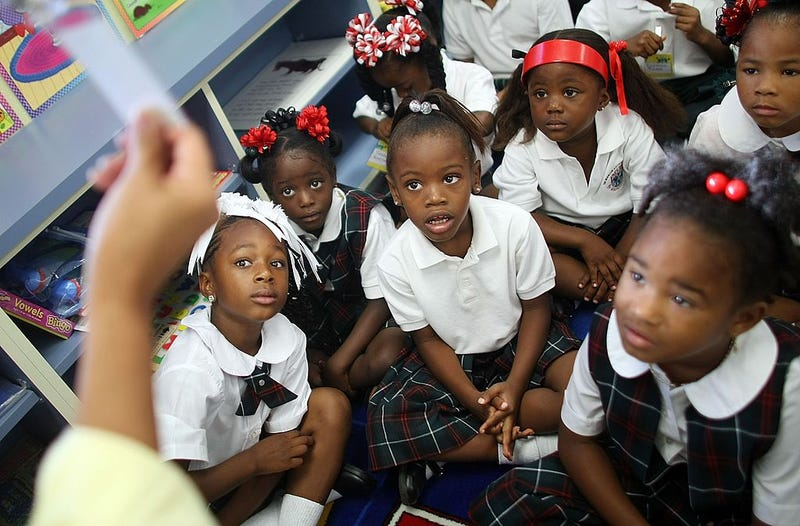 Kindergartners on their first day of school at Dr. Martin Luther King Jr. Charter School for Science and Technology in the Lower 9th Ward on Aug. 20, 2007, in New Orleans. The school reopened after closing  post-Hurricane Katrina  in 2005. (Mario Tama/Getty Images)