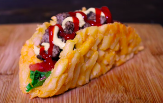 Illustration for article titled This french fry burger taco proves that happiness comes in many forms